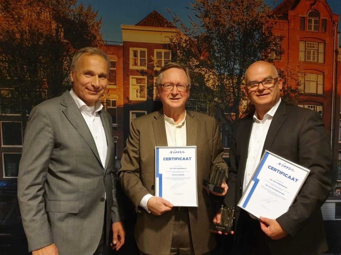 Twee NIMA-iconen worden benoemd tot Lid van Verdienste